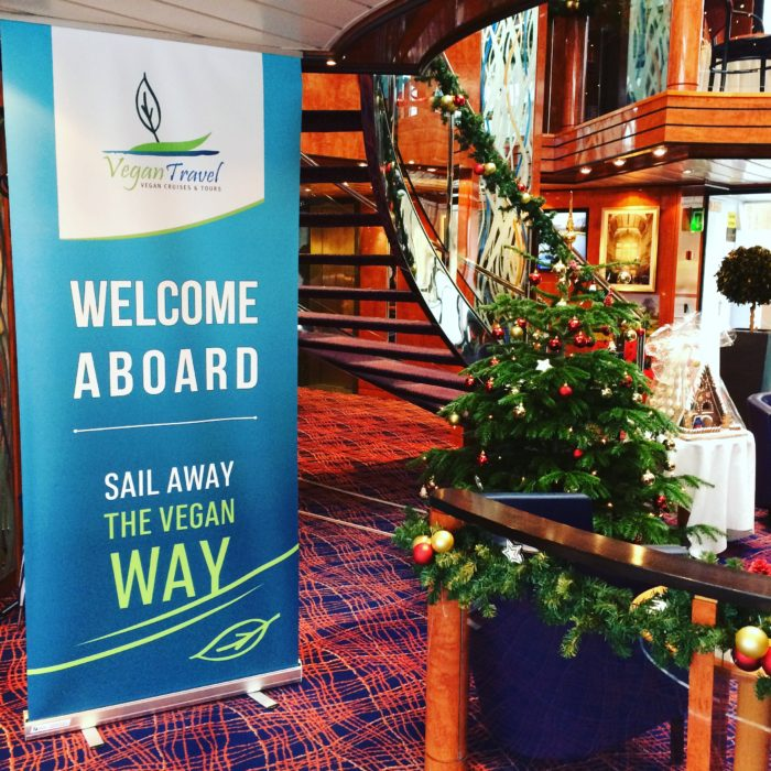 vegan cruises Vegan Travel banner in river ship lobby