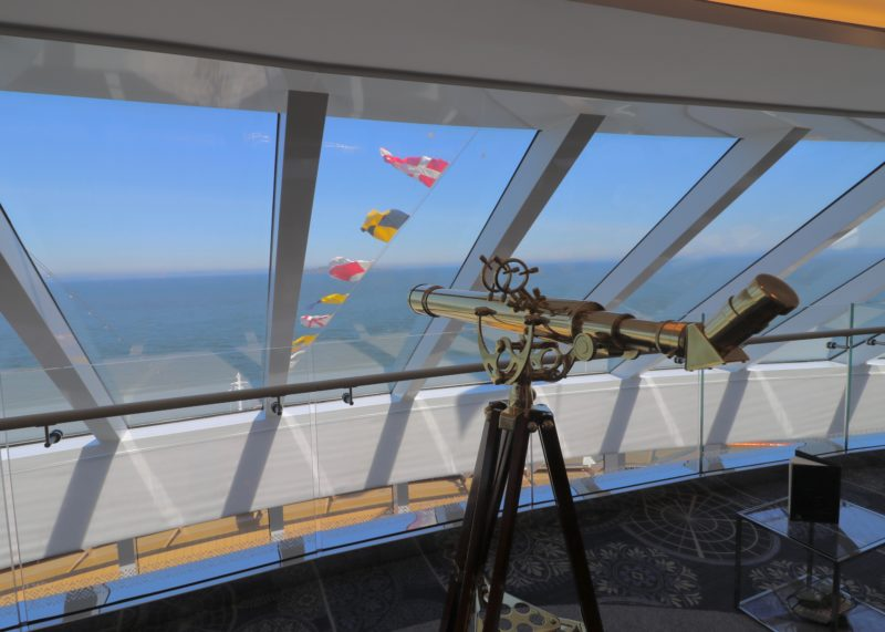 view out of Explorer's Lounge top level with ship flags on view